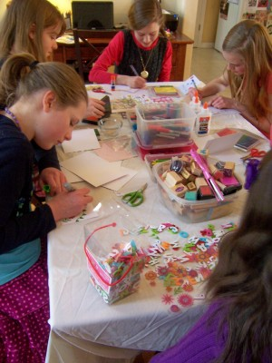rubber-stamping, stickers, glitter glue to create greeting cards