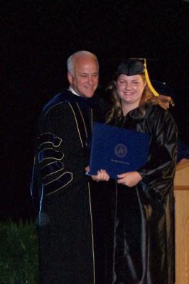 Kotch receiving her diploma (after a 3.4gpa record in her four years) from President Dr. Towey