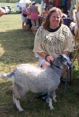 Jane wearing Not-So- Plain-Jane shawl and one of her champion goats