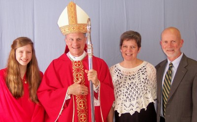 "Kit, Archbishop of the Military Broglio and Kit's beaming parents.  I'm wearing ""The Yarn Has Spoken"" poncho."