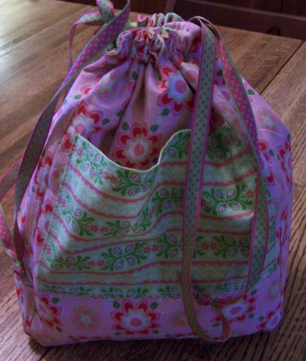 Inside is now outside with a large pocket and pretty coordinating fabric.