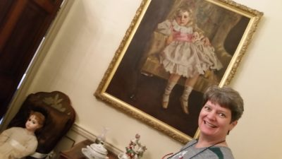 Christie as a 5-year-old; the chair holds the doll she has in the portrait.