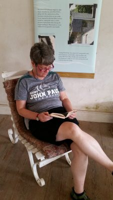 Reading Dead Man's Folly in the boathouse she used in her story.