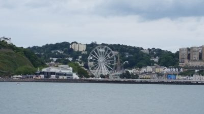 """Torquay's """"Riviera Wheel"""" and the harbor area from the train coming in from Paignton"""