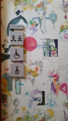 Two things:  how they define the gender-specific bathrooms and the wallpaper is all cartoony pix of Di